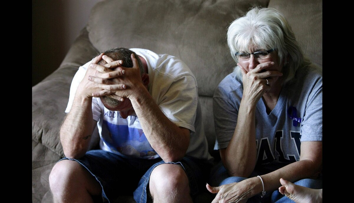 Victoria Stafford's father Rodney Stafford and grandmother Doreen Graichen are overcome with emotion as they watch a police press conference on television on May 20, 2009 in Woodstock, Ontario.