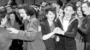 Nimble-footed sailors from Great Britain grabbed their partners in a whirl of spontaneous street dancing in downtown Toronto on Monday, May 7, 1945 as the first news of Germany's surrender reached North America.