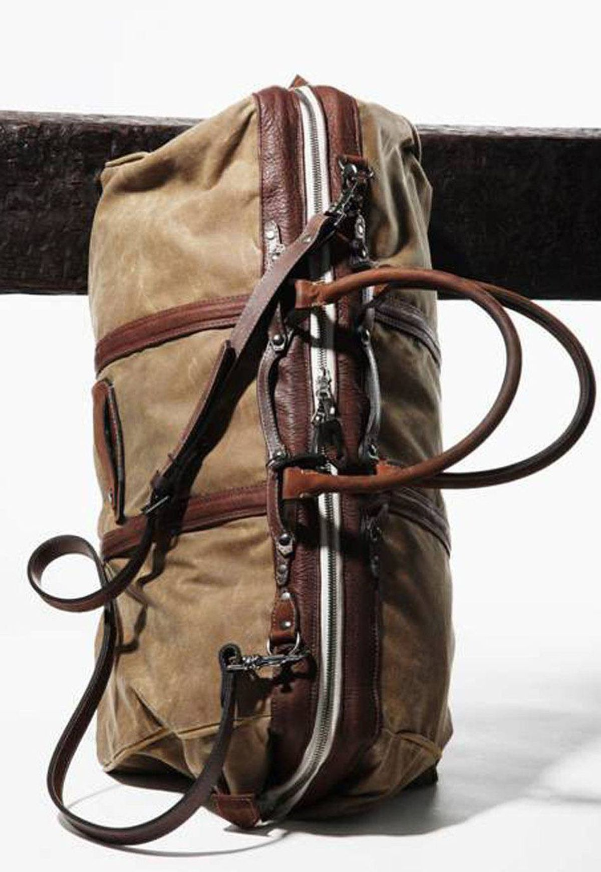 Duffle by Chow Go faux-vintage on your next weekend getaway with Krane's Haley bag. Made in Canada by men's wear designer Ken Chow, the roomy duffle has the worn-in look and no-nonsense durability of your favourite leather jacket. The design, however, is anything but old-fashioned. Chow graduated from New York's Fashion Institute of Technology and interned with Marc Jacobs - his precise tailoring technique gives the bag an edgy industrial chic look. $905; kranedesign.com