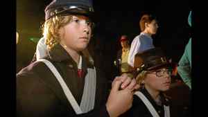 William McCaskill, 10, left, and his brother Alex McCaskill, 7,of Lugoff, SC, gather at White Point Garden near Fort Sumter Tuesday, April 12, 2011 for a candlelight sunrise concert to commemorate the moment the first shots of the Civil War were fired in Charleston, S.C.
