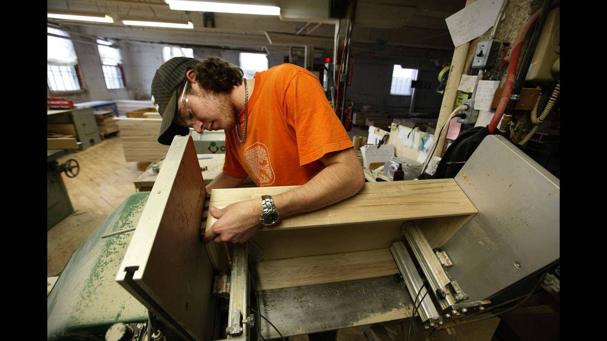 BG Furniture employee Taylor Ross assembles a drawer at the company's wood furniture factory in Walkerton, Ont.