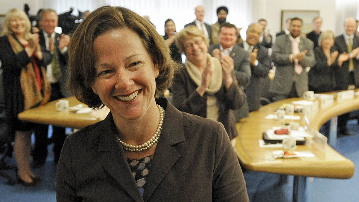 Alberta Premier-elect Alison Redford is greeted by her new Progressive Conservative Party caucus in Edmonton on May 2, 2012.