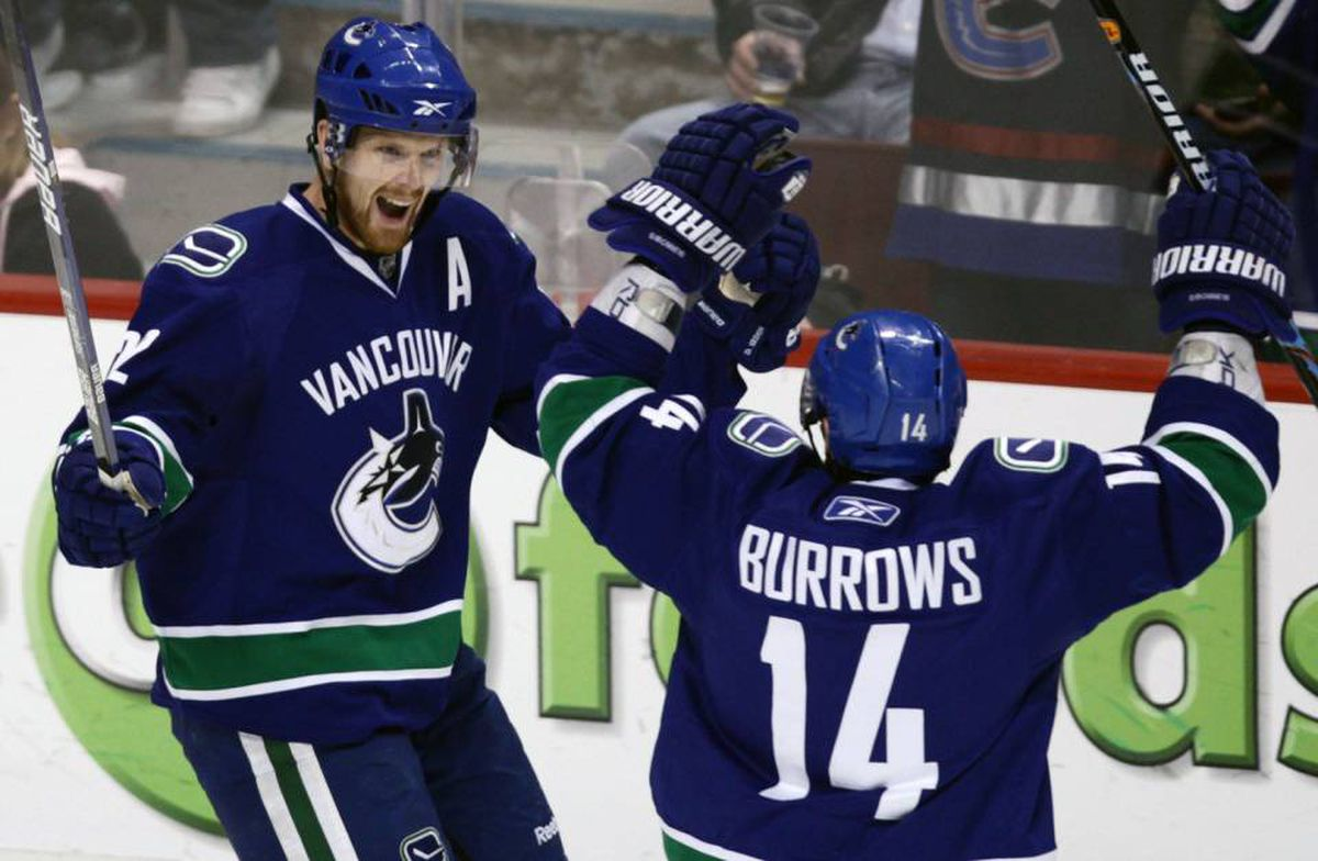 Vancouver Canucks' Daniel Sedin, left, of Sweden, and Alex Burrows celebrate Sedin's third goal of the game against the Calgary Flames during third period NHL hockey action in Vancouver, B.C., on Saturday April 10, 2010.