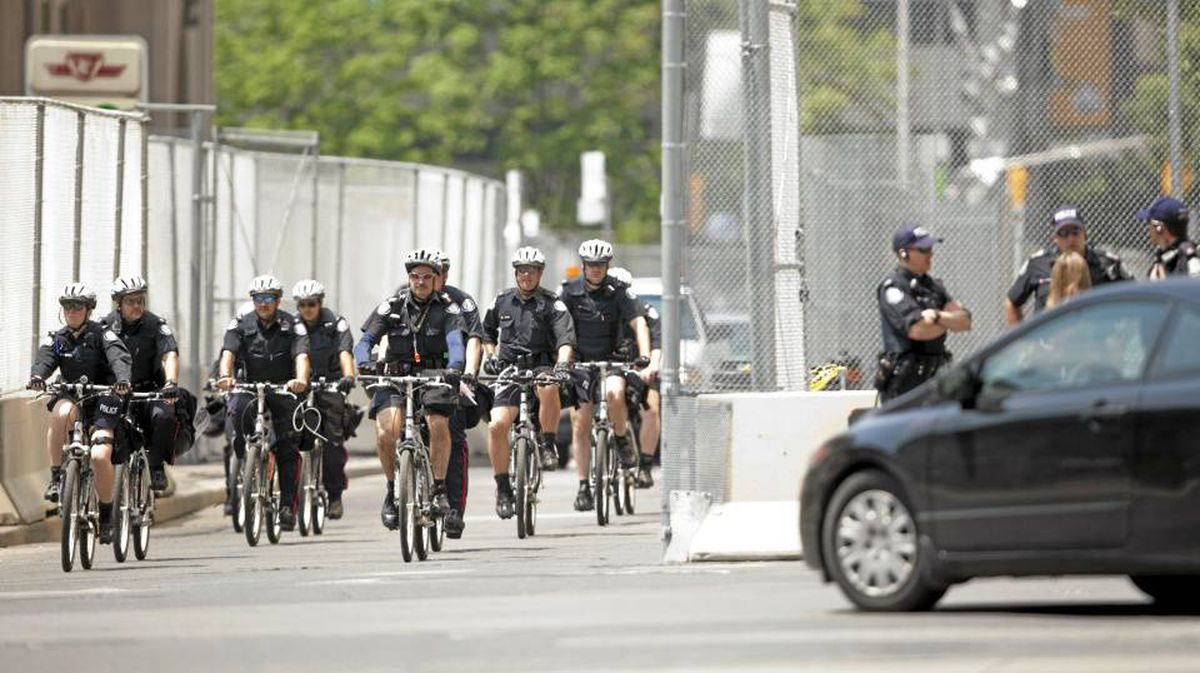 Police canvass the streets on June 25, 2010 in Toronto, Canada.
