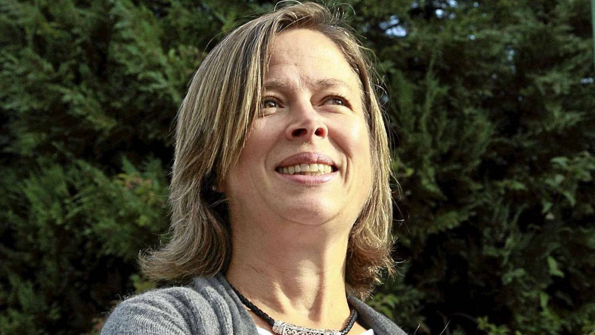 Caroline Adderson photographed in the Kitsilano neighborhood of Vancouver, the area where her novel takes place.