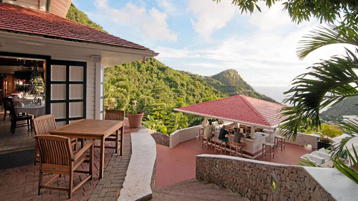 Perched high on a dormant volcano, the view from Queen's Garden Resort is more Tahitian than Caribbean.