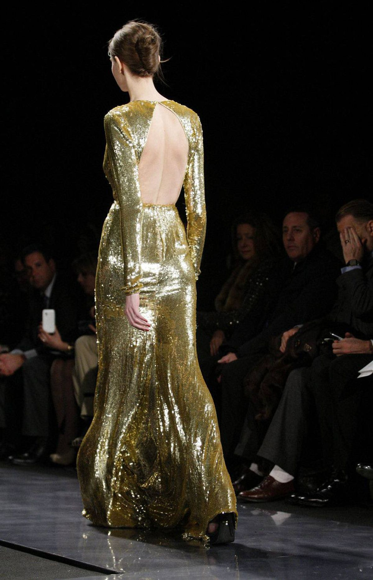 The last few gowns went full-throttle glamour. Still, Kahn has balanced the open back and plunging neckline with long sleeves.