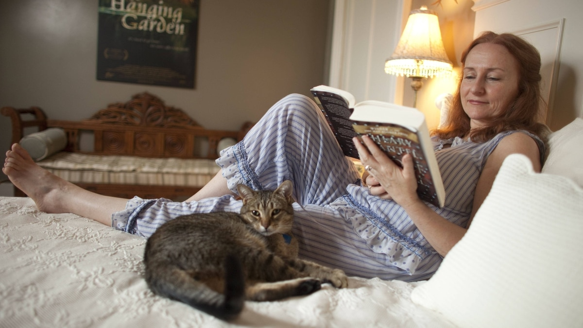 Stratford actor Seana McKenna reads in bed at her home in Harrington, Ontario.