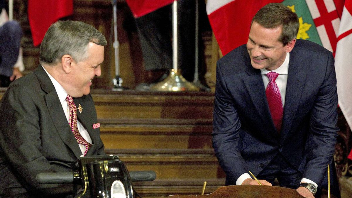 Ontario Premier Dalton McGuinty shares a laugh with Lieutenant-Governor David Onley as he swears in his cabinet at Queen's Park in Toronto on Oct. 20, 2011.