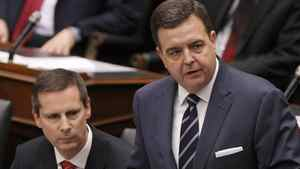 Ontario Finance Minister Dwight Duncan (R) delivers the provincial budget as Premier Dalton McGuinty looks on at Queens Park in Toronto, March 27, 2012.