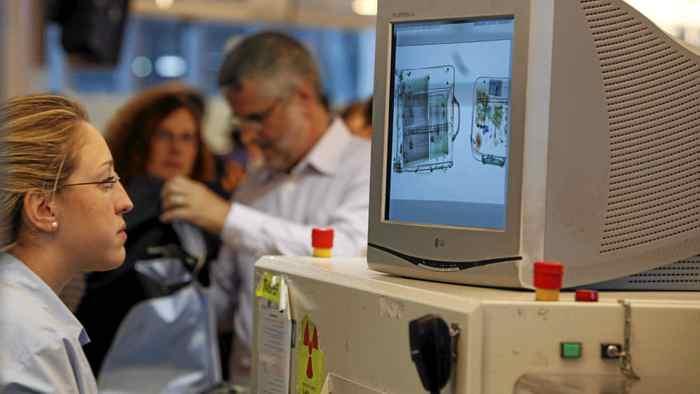 Passengers go through security checks in the departure hall at Ben Gurion international airport near Tel Aviv.