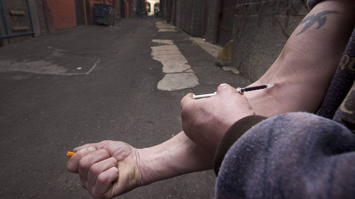 An intravenous drug user injects heroin in Vancouver's downtown Eastside.
