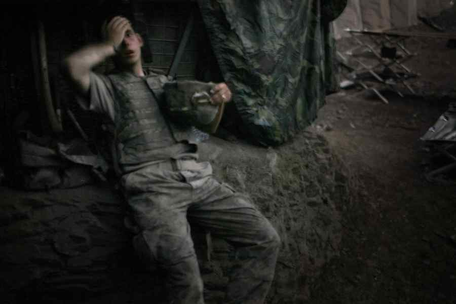 An exhausted American soldier at 'Restrepo' bunker. This photo was chosen the World Press Photo of the Year in 2007.