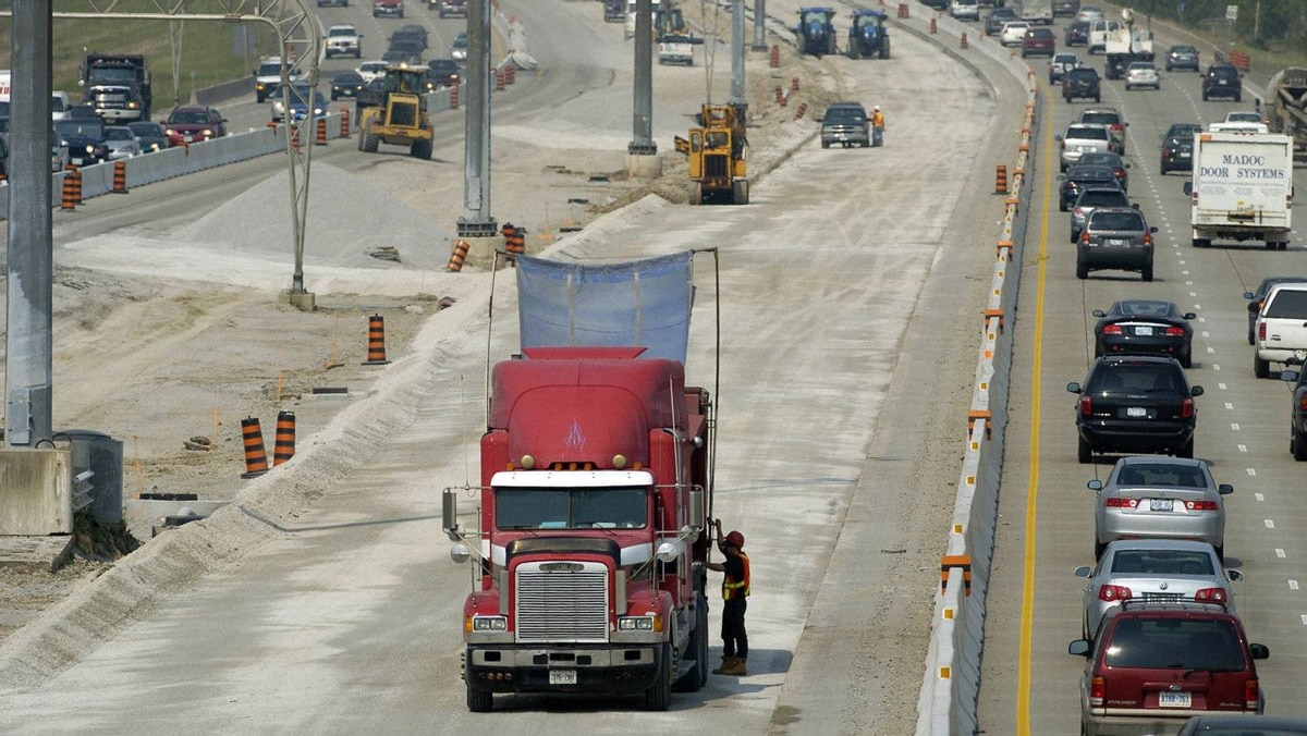 File phonot of Aecon road crews working on Highway 407 near Highway 427 in Toronto.