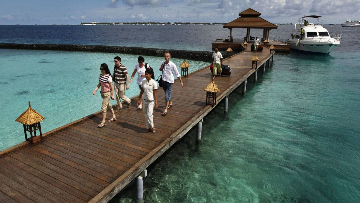 Foreign tourists arrive in a resort in the Kurumba island in Maldives. Tourism is the main industry in the Maldives, a chain of nearly 1,200 islands off southern India blessed with sandy beaches and coral.