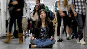 Student Sabina Wex is pictured demonstrating her meditation technique in a hallway at North Toronto Collegiate Institute. Wex practices meditation and yoga during a 'stress busters' program initiated by the school's guidance department.