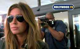 "This video frame grab, provided by Hollywood TV, shows Rachel Uchitel at Los Angeles International Airport Nov. 29, 2009. Ms. Uchitel denied tabloid reports she had had a ""jet-set liaison"" with Tiger Woods."