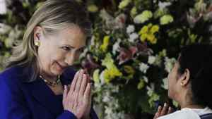 U.S. Secretary of State Hillary Rodham Clinton, left, and West Bengal Chief Minister Mamata Banerjee greet each other before a meeting in Kolkata, India, Monday, May 7, 2012.