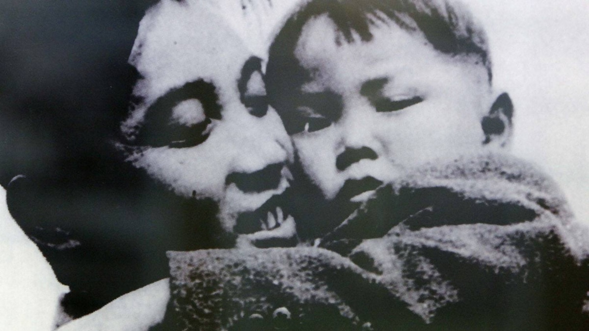 A photograph of former North Korean founder Kim Il-Sung hugging his son Kim Jong-il, which was taken in April 1946, is displayed at the Unification Hall at the West Seoul Life Science High School in Seoul.