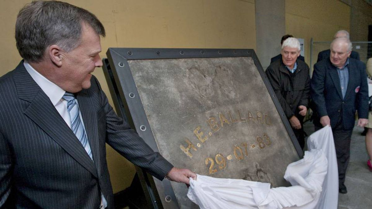 """Bill Ballard and Terry Clancy, sons of the late Harold Ballard and Francis Michael """"King"""" Clancy unveil a slab of concrete encasing former Toronto Maple Leafs owner Harold Ballard's handprints and footprints, with the help of former Toronto Maple Leaf Ron Ellis (far right). The slab was removed from the ice pad of Maple Leaf Gardens and is being donated to the Hockey Hall of Fame by Ryerson University and Loblaw Companies Limited."""