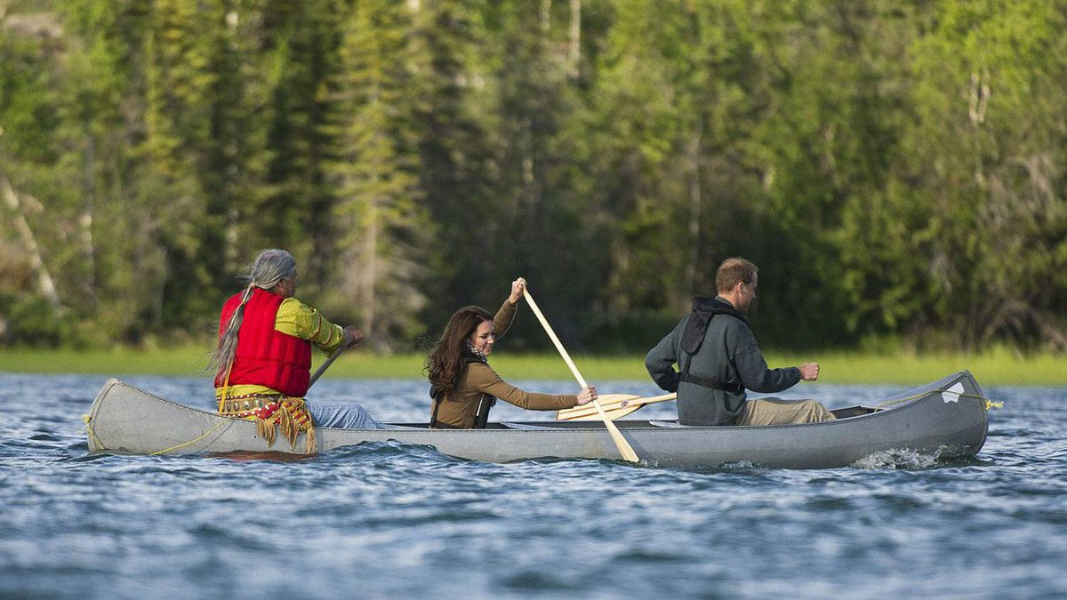 The Duke and Duchess of Cambridge take a canoe ride with elder Francois Paulette from the Fort Smith area at Lake Blatchford Lake, N.W.T., lodge on July 5, 2011.