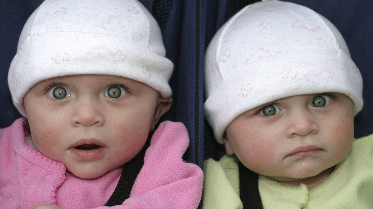 Identical twin girls make funny faces
