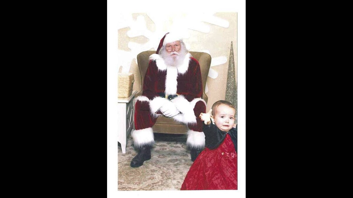 Sue Desilets photo: Help mommy - 18 month old Elizabeth enjoying her visit with Santa