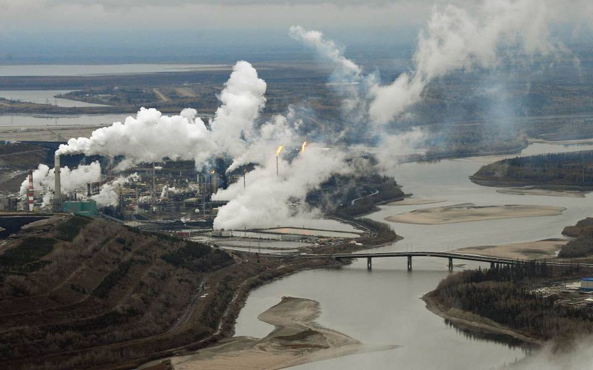 Aerial view of the Suncor oil sands extraction facility on the banks of the Athabasca River and near the town of Fort McMurray, Alta.