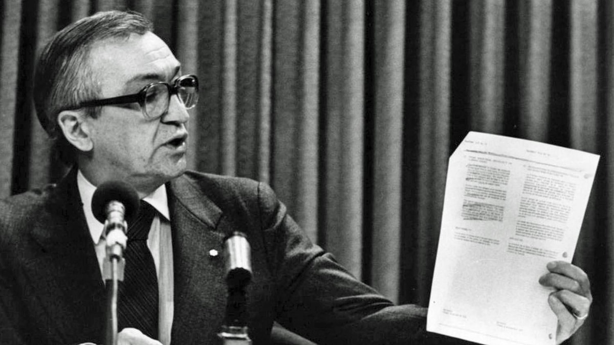 CBC President Pierre Juneau holds up a policy statement during a news conference in Ottawa, Oct.18, 1982.