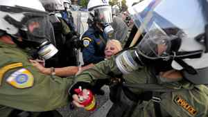 Anti-riot police try to detain a demonstrator in Thessaloniki, northern Greece.
