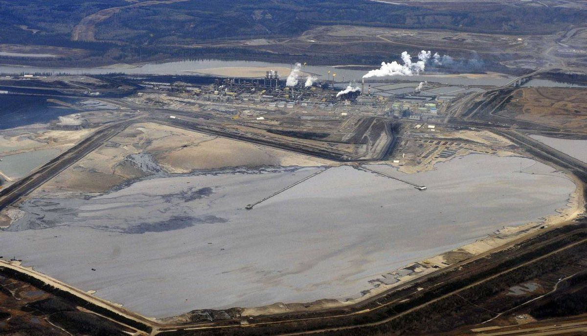 The Suncor tar sands plant and tailings pond at their tar sands operation north of Fort McMurray, Alberta, November 3, 2011. A tailings pond holds all the toxic waste from oil sands extraction process.