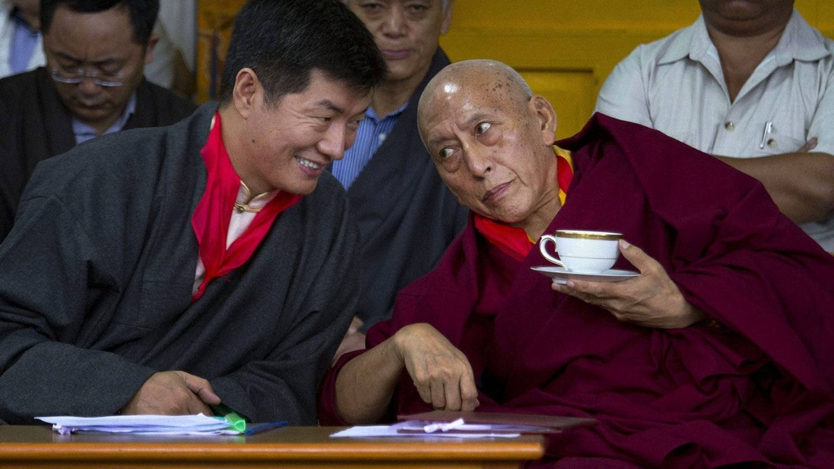 """Mr. Sangay, left, speaks with outgoing Prime Minister Samdhong Rinpoche during his swearing-in ceremony. He said the election is """"a clear message to the hardliners in the Chinese government that Tibetan leadership is far from fizzling out."""""""