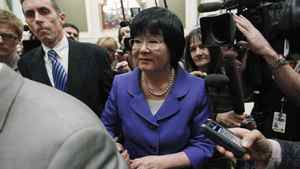 Canada's International Cooperation Minister Bev Oda (C) is escorted past journalists after testifying before the Commons Procedure and House Affairs committee on Parliament Hill in Ottawa March 18, 2011.