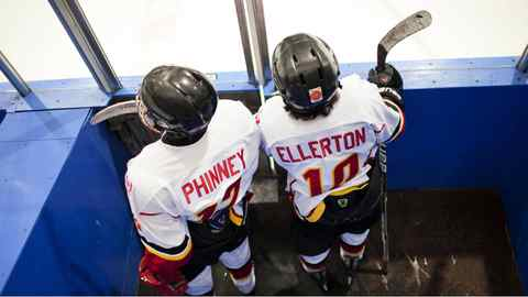 Two members of the Leaside Flames Bantam AA team sit in the penalty box during a GTHL hockey game at St. Michael's arena.