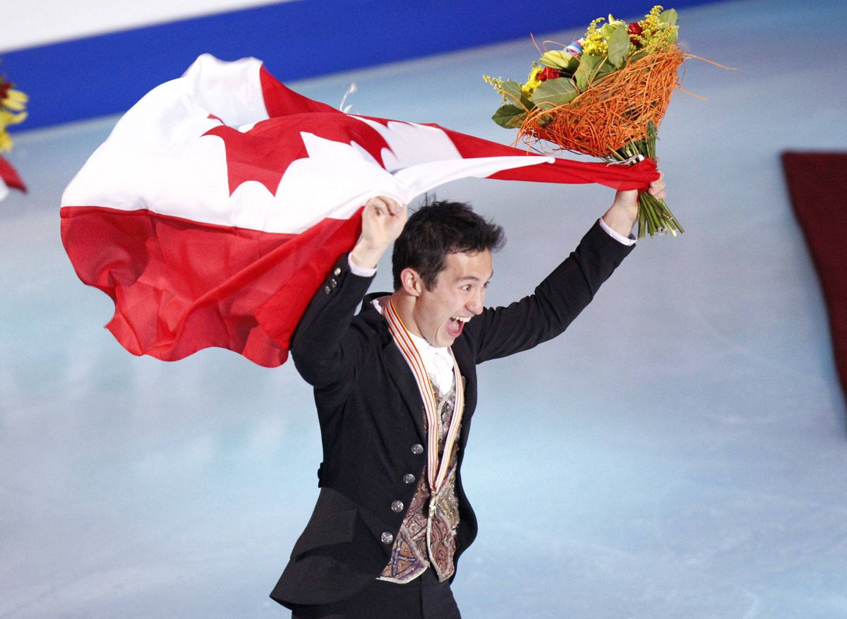 Gold medalist Canada's Patrick Chan skates with the national flag after the free program at the ISU Figure Skating World championships in Moscow, Russia.