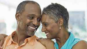 A couple with greying hair hugging.