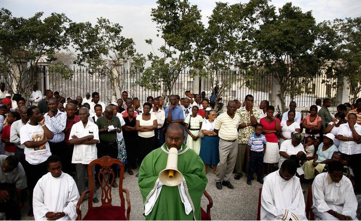 A priest talks to his congregation through a megaphone during mass outside of the Port-au-Prince cathedral that was destroyed by the magnitude 7.0 earthquake more than two weeks ago.