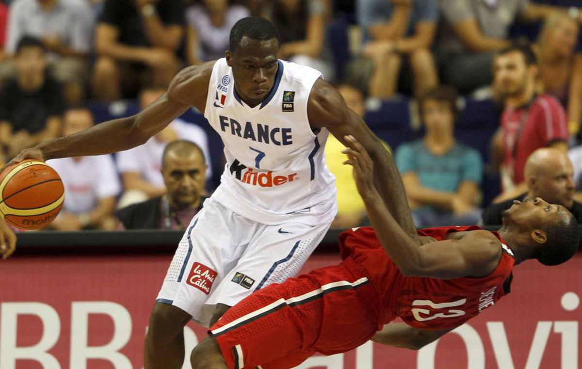 France's Alain Koffi makes contact with Canada's Jevohn Shepherd during their FIBA Basketball World Championship game in Izmir on Tuesday.