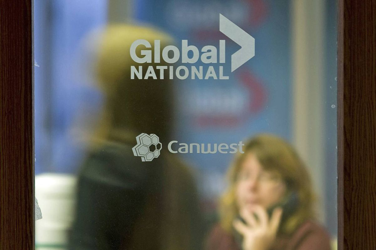 A secretary talks on the phone at the Canwest and Global TV offices in Ottawa on Oct. 6, 2009.