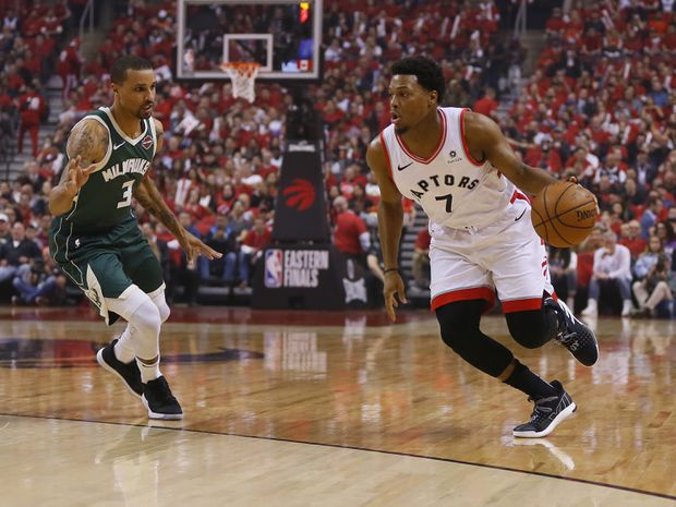 190150a3a4c Toronto Raptors guard Kyle Lowry (7) dribbles the ball past Milwaukee Bucks  guard George Hill (3) during game four of the Eastern conference finals of  the ...
