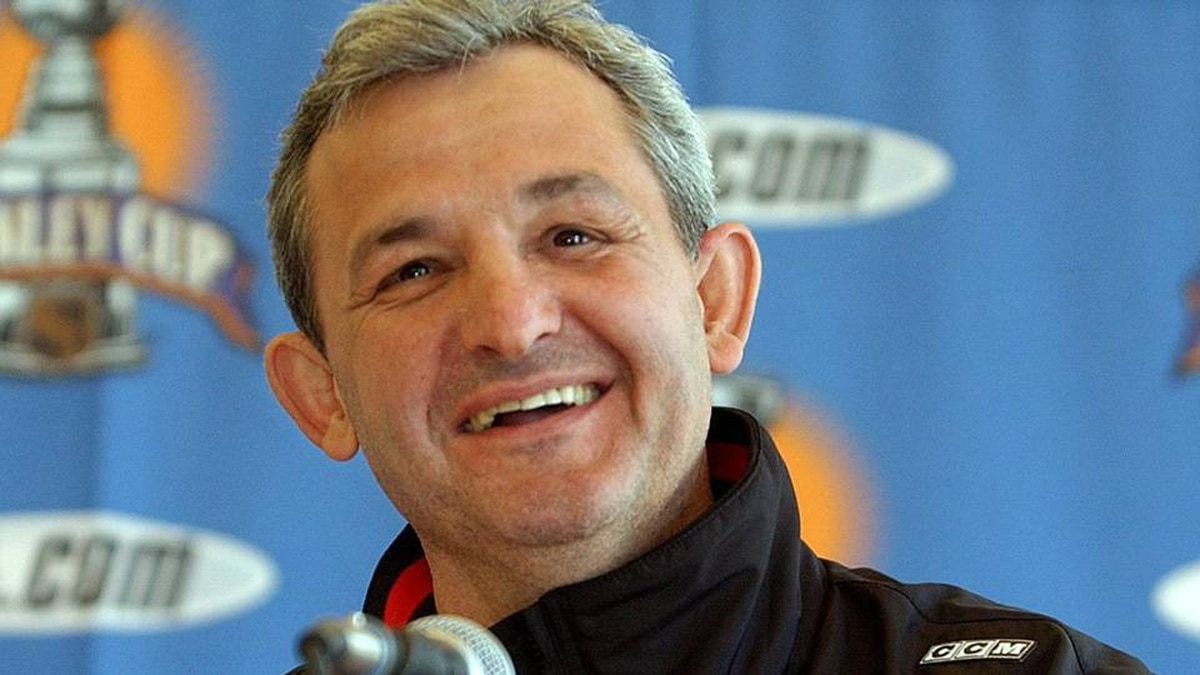 Darryl Sutter smiles during a news conference in San Jose, Calif., Monday, May 10, 2004.