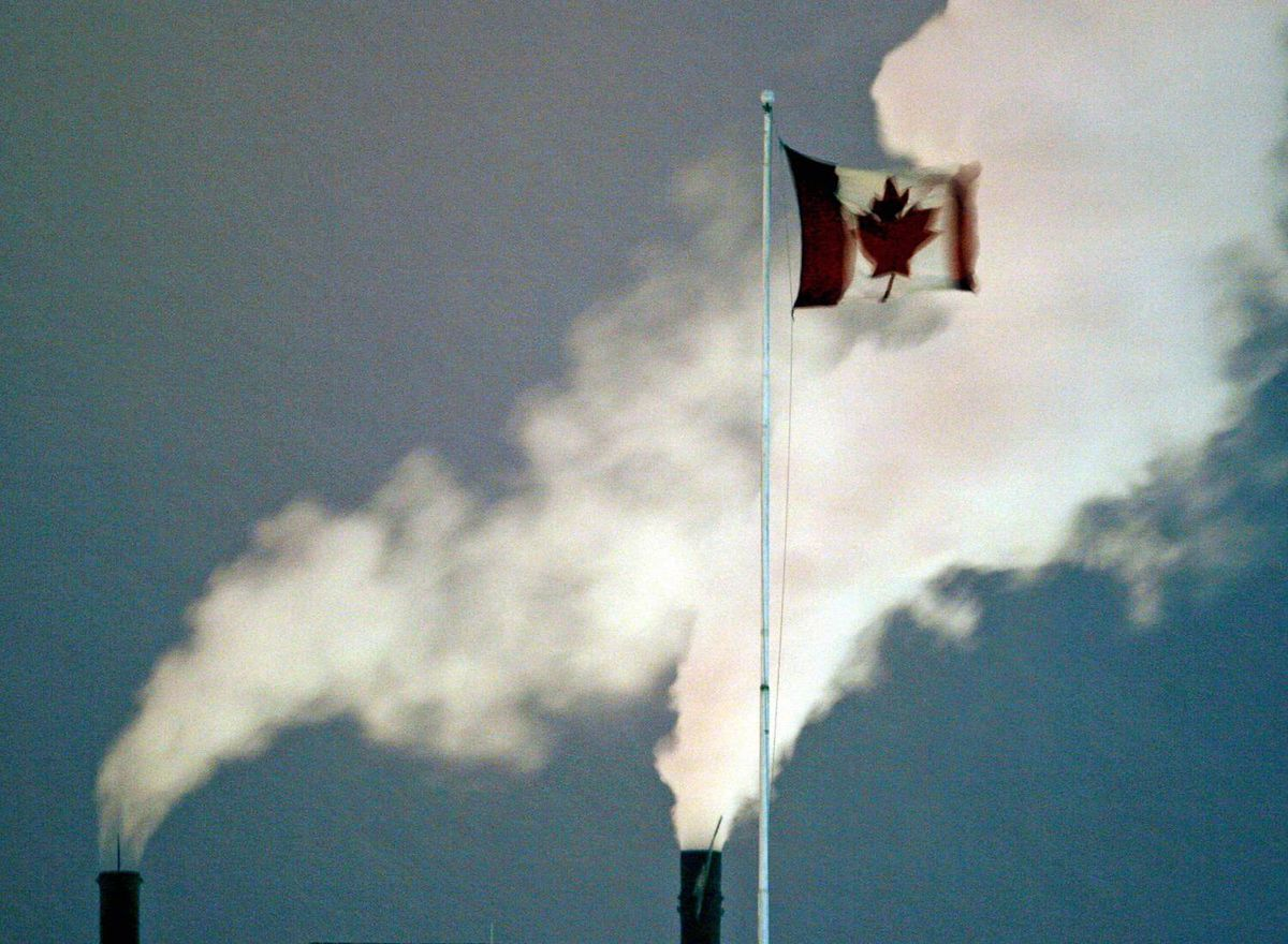 A Canadian flag flies in front of smoke stacks at a steel mill in Hamilton in February of 2007.