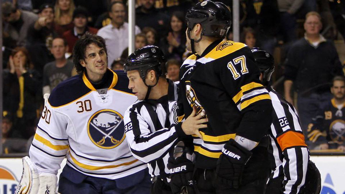 Buffalo Sabres goalie Ryan Miller (30) has some words with Boston Bruins left wing Milan Lucic (17) after being charged during the first period at TD Banknorth Garden.