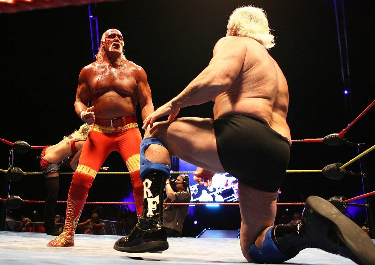Hulk Hogan gestures to Rick Flair during his Hulkamania Tour at the Burswood Dome on November 24, 2009 in Perth, Australia.