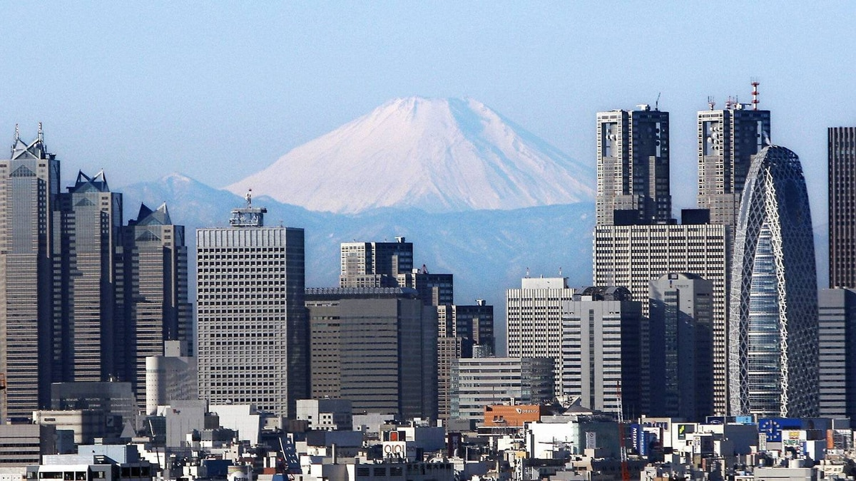 Mount Fuji looms over the Tokyo skyline. This week, Japan reported its first annual trade deficit since 1980, caused by the impact of the March 11 earthquake, tsunami and energy crisis and a decline in exports attributable in part to the strong yen.