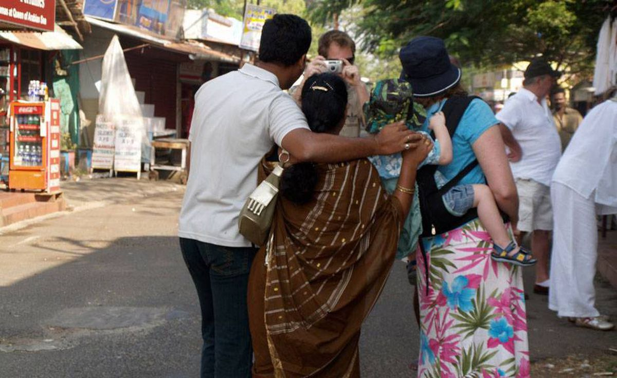 Indian honeymooners take a photo with us in a country where foreign children are a rare sight – and treat – for the locals.