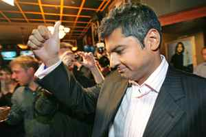 A dejected Rahim Jaffer gives the thumbs up after falling behind in the Edmonton-Strathcona riding at Tory headquarters on Oct. 14, 2008.