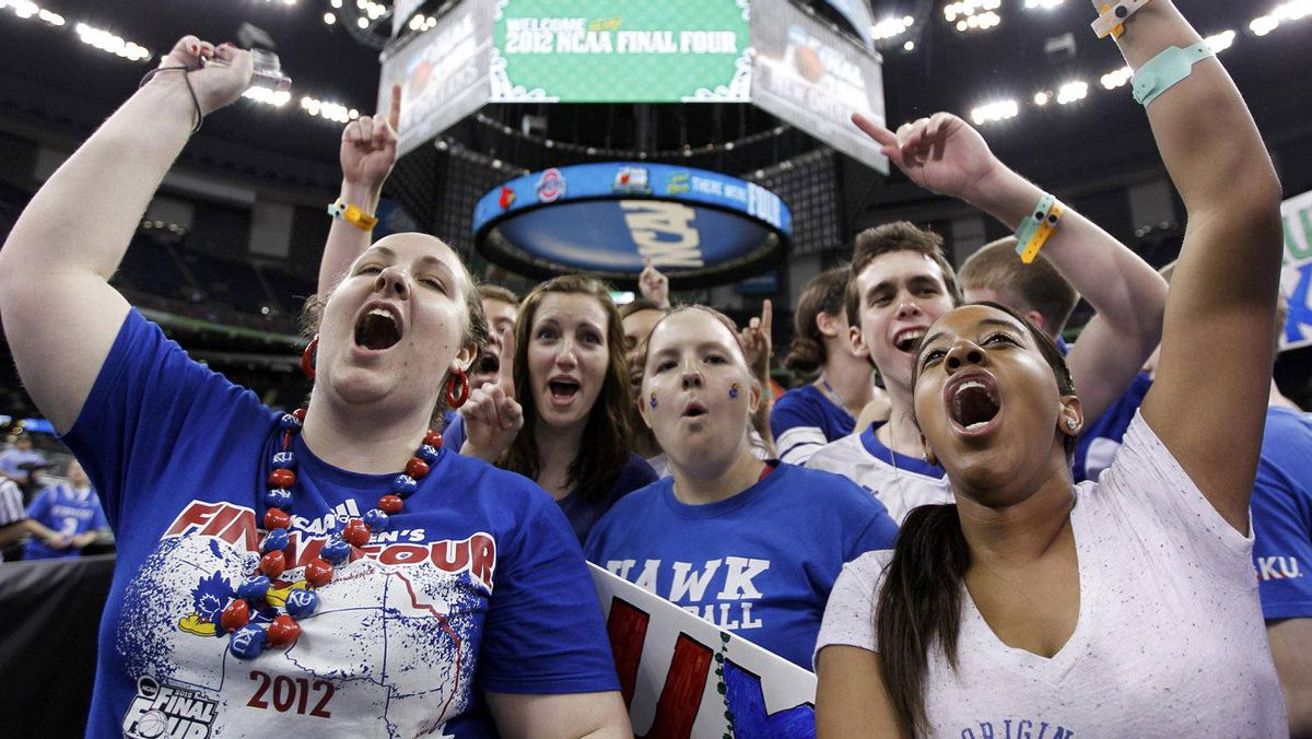 Kansas Jayhawks fans cheer ahead of the men's NCAA Final Four semi-final college basketball games in New Orleans, Louisiana, March 31, 2012. Kansas will face the Ohio State Buckeyes in the second game. REUTERS/Lucy Nicholson