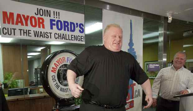 Toronto Mayor Rob Ford jokes around while standing on a scale during a weigh in marking the start of a 6 month weight loss challenge that Ford and his brother Doug are attempting in Toronto on Monday, January 16, 2012. Ford weighed in at 330lbs and hopes to loose 50lbs by June 18th.