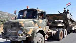 A handout picture from the Syrian Arab News Agency (SANA) shows Syrian soldiers withdrawing on army lorries on August 10, 2011, from the city of Hama after a 10-day military operation to quell pro-democracy protests.